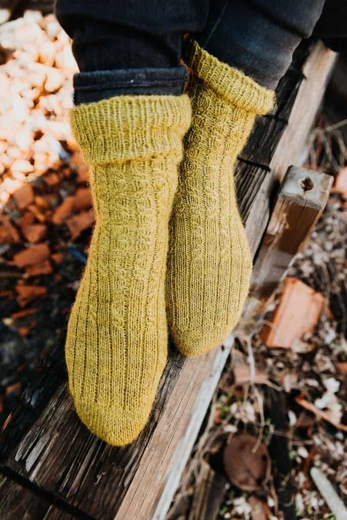 Feet modelling a pair of handknit Tidal socks