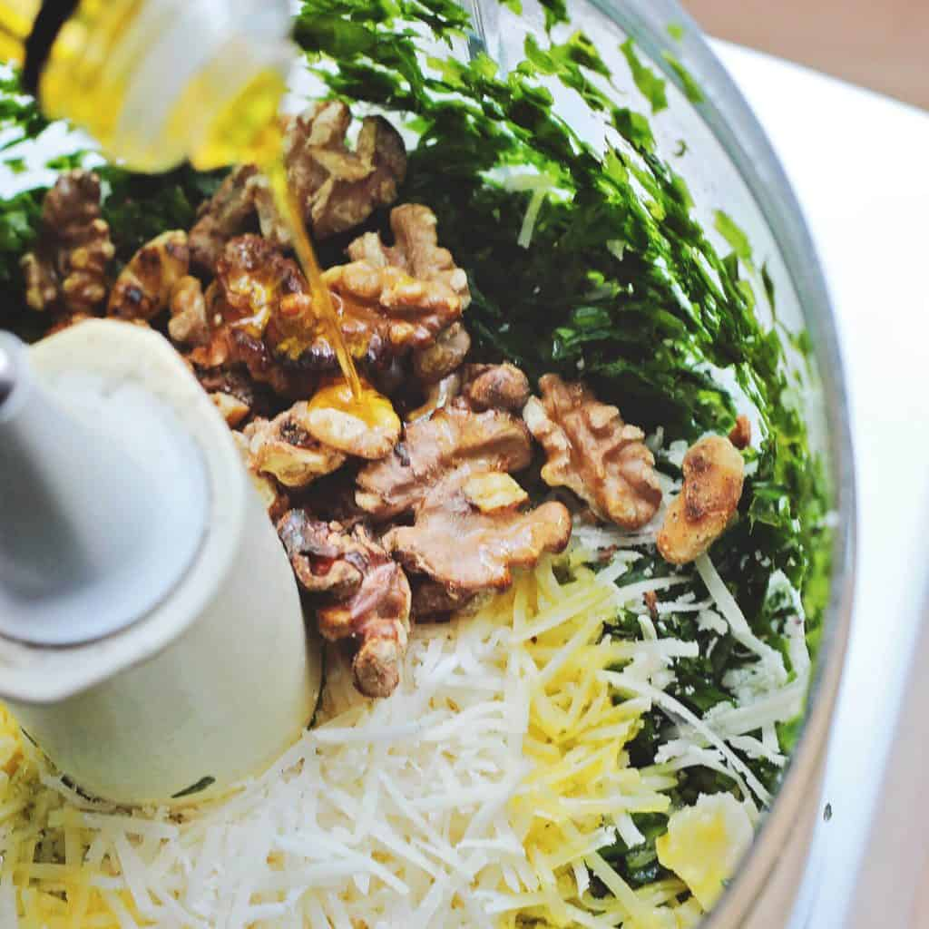 wild garlic pesto ingredients in a food processor